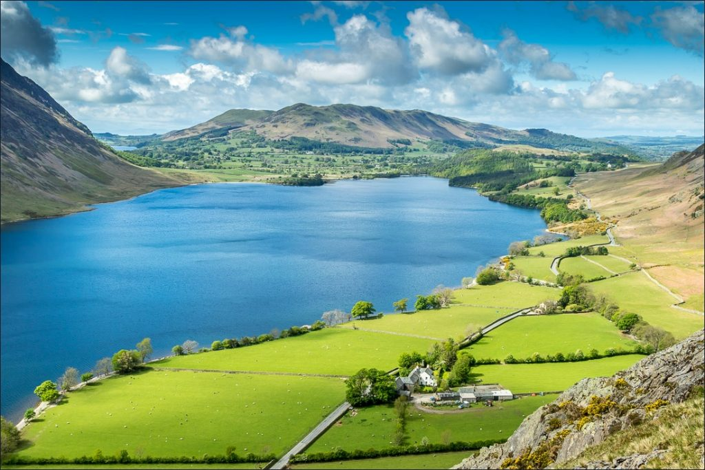 View overlooking the foot of Crummock Water with Low Fell beyond.